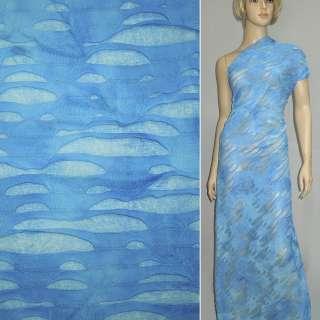 Трикотаж голубой рваный ш.150