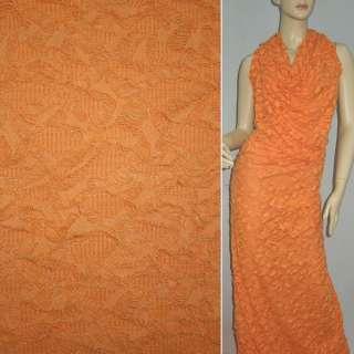 Трикотаж оранжевый рваный ш.150