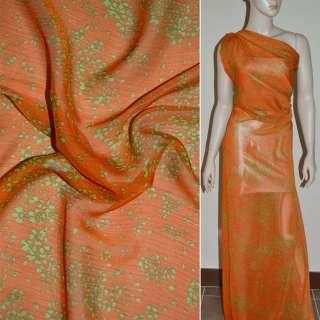 Шифон жатый оранжевый с мелкими зелеными цветами ш.140