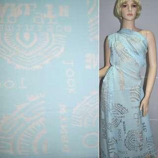 Вискоза деворе голубая с абстрактным рисунком и надписями ш.134 см