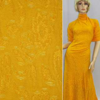 Трикотаж вискозный желтый с ажурным петельным переплетением ш.140