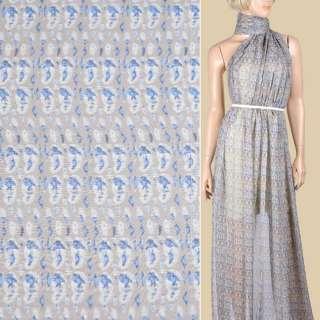 Шелк коричневый светлый с молочно-синей абстракцией ш.136