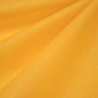 Флизелин неклеевой (спанбонд) желто-мандариновый, плотность 80, ш.160