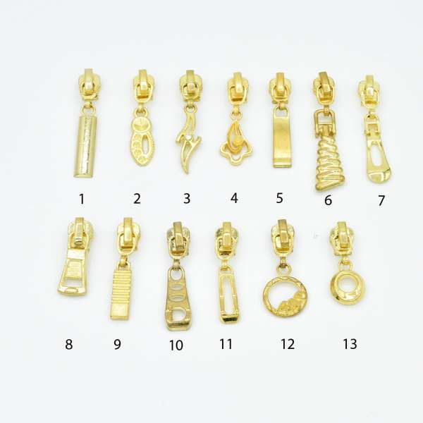 Бегунок на металлическую молнию №3 золото с фигурным язычком