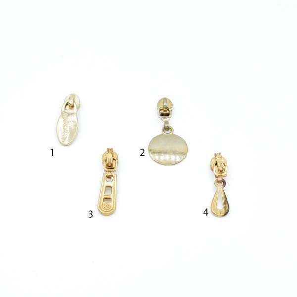 Бегунок на спиральную молнию №3 золото с фигурным язычком